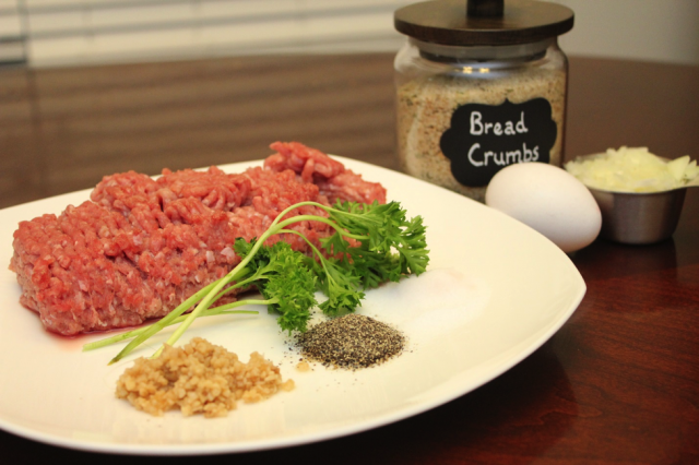 Raw meat and spices in preparation to make turkey burgers