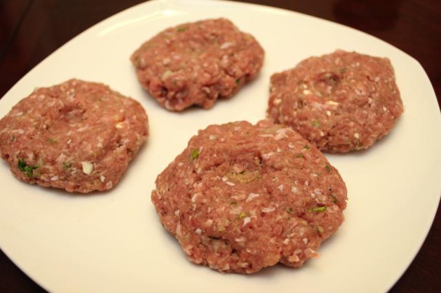 Raw turkey burger patties