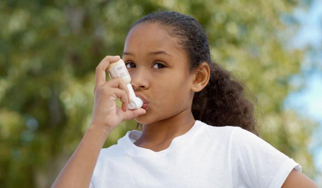 Girl using inhaler for Asthma