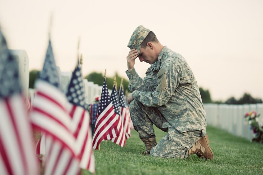 Serviceman honoring fallen soldiers