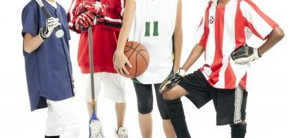 Kids in different sports uniforms