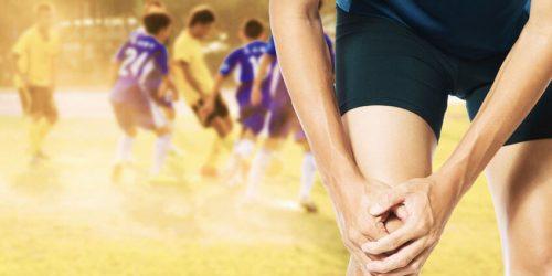 runner grabbing his knee in pain