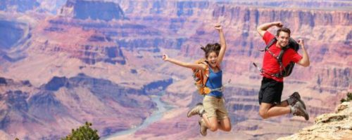 People jumping at the Grand Canyon