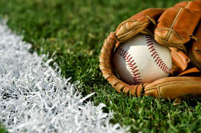 Baseball in a baseball mitt on a field