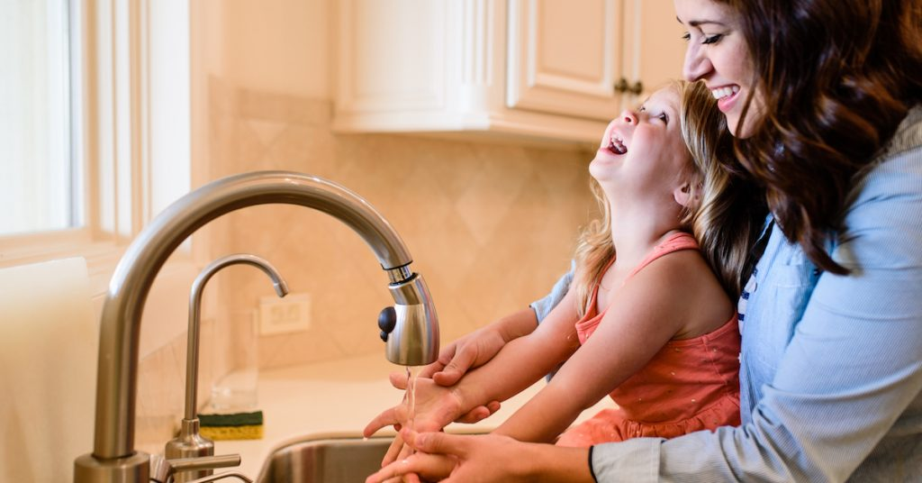 Picture of a Mother and Daughter Washing Hands