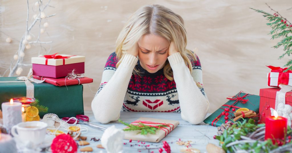 Picture of a woman stressed about the holidays