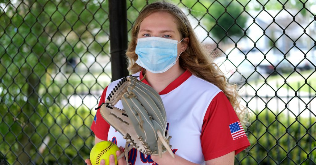 Picture of a softball player in a mask