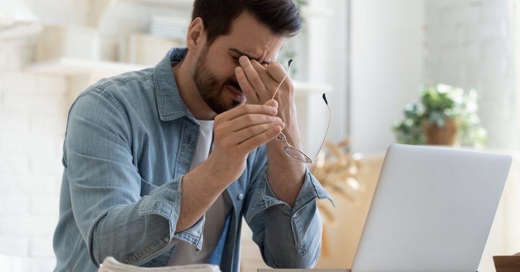 Image of man rubbing his eyes.