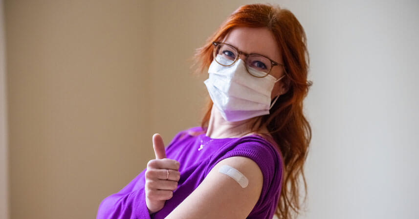 Happy woman after getting the COVID-19 vaccine
