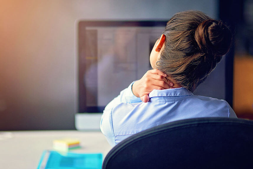 woman with acute pain in office